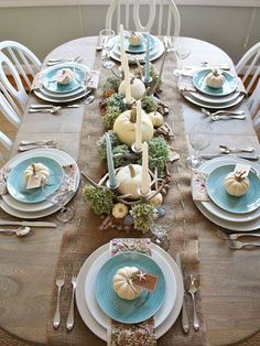 Down by the Sea   Although the temperature may be dropping and the leaves may be changing color in many places, somewhere in the country, the beach beckons. White and Tiffany-blue plates and candles help set the scene for this coastal Thanksgiving table setting, but perhaps not as much as the centerpiece of white pumpkins, starfish, and clam and scallop shells. Birch bark, acorns, dried hydrangeas, and silver antler candelabras give an extra nod to the wonders of nature. Kim Wilson shares…