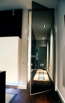 Hallway by Isolina Mallon Interior Design. Transparent grey glass by Rimadesio