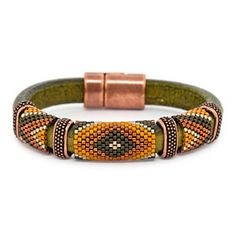 Regaliz leather with peyote bands and copper components