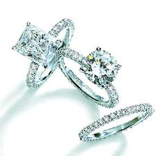 the top one is my dream engagement ring. future fiance take note. ;)