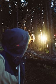She looked towards the sun which was halfway fallen between the trees. In her mind it looked beautiful but then she realized she had to get back to camp before dark
