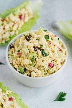 Vegan Chicken Salad made with tofu, celery, almonds and raisins. So delicious, packed with protein and great for sandwiches and wraps!