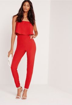 Every girl needs their go-to jumpsuit and this fiery red beaut is the one to watch. Featuring a bandeau and double layer style, you'll be raising the temps from head-to-toe. Get an instant style upgrade by teaming with barely there heels an...