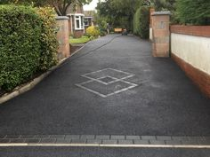 ampatioanddrivewaysltd.co.uk/   A M Patio & Driveways Limited  Installing Driveways Built to Last for Over Four Generations Tarmac Driveways, Resin Bound Driveways, Patio Installation, Blackpool, Stepping Stones, Places To Visit, Sidewalk, Instrumental, Building