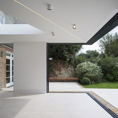 flush floor finishes of IQ sliding doors allow merging of internal and external spaces