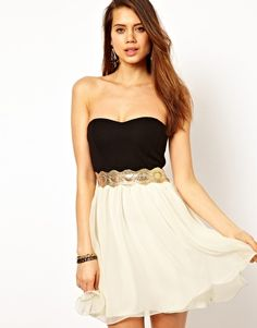 black and white strapless dress with gold greek-looking belt