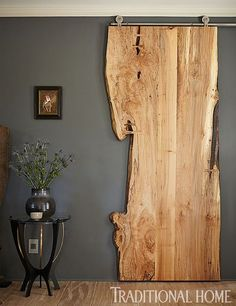 If it weren/u2019t for that metal track this piece of live edge wood would never suggest it actually serves as a door. Though it may not be a best option as a front door, it/u2019s definitely one of the most interesting sliding doors we could find..