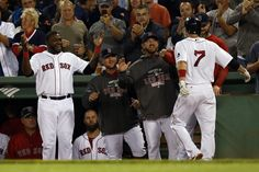 CrowdCam Hot Shot: Boston Red Sox designated hitter David Ortiz welcomes shortstop Stephen Drew to the dugout after he hit a two run homer off Baltimore Orioles pitcher Chris Tillman during the second inning at Fenway Park. Photo by Greg M. Cooper