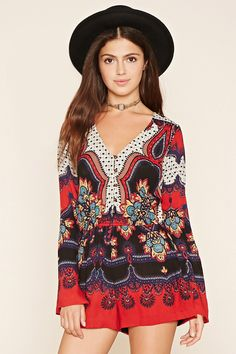 A woven abstract print romper with long bell sleeves, a buttoned placket at the V-neckline, and an elasticized waist.