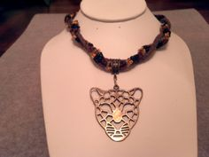 SOLD. Leopard pendent Beaded and braided leather necklace lobster closure