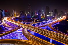 The speed of light: Exposure blurs the headlights of zooming cars on Shanghai's elevated freeways in this shot by Paul Reiffer