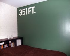 I painted the wall in my last bedroom to mimic an old baseball fence.  http://www.seanengelhardt.com/blog/2010/04/i-painted-a-wall-on-my-wall/