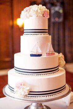 We are loving this sailboat wedding cake topper for nautical or beach weddings. And you know what? The sailboats do not have to be stuck in port at the top of your cake; instead, place on the tiers, as shown below, to make it look like they're sailing on by…