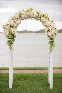 Floral Wedding Arch | On SMP -- http://www.StyleMePretty.com/massachusetts-weddings/2014/01/23/cape-cod-wedding-at-wequassett-resort-and-golf-club/  Deborah Zoe Photography