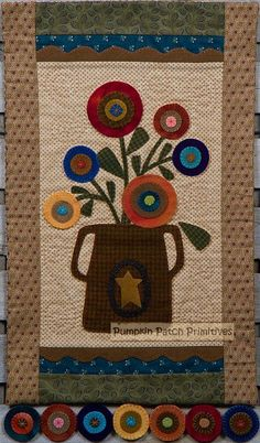 Fun, simple flowers in an Old Brown Pot.  Patterns at http://www.pumpkinpatchprimitives.com/catalog.php?item=1806