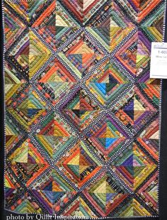 """Mark the X"" by Carol Esch and Lois Walter (New Jersey). Photo by Quilt Inspiration. 2014 AQS quilt show."