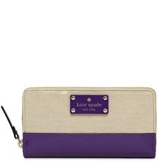 Adorable Kate Spade wallet with purple details.