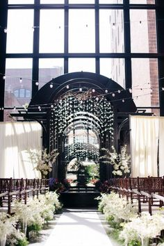 Gorgeous ceremony space decorated with white flowers | Photo by GH Kim Photography via http://junebugweddings.com/wedding-blog/classy-seattle-wedding-court-square/