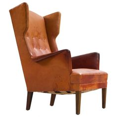 Frits Henningsen Wingback Lounge Chair in Original Cognac Leather   From a unique collection of antique and modern wingback chairs at https://www.1stdibs.com/furniture/seating/wingback-chairs/
