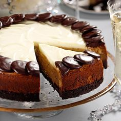 Cappuccino Cheesecake Recipe -Instead of pouring the decadent ganache over the top of this coffee-flavored cheesecake, I use most of it to cover the chocolate crust.—Linda Stemen, Monroeville, Indiana