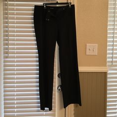 "Tahari slacks SZ 10 SZ 10 Tahari black slacks with pink pinstripe.  Inseam 33"", waist 16"". Very Slight wear on bottom pant legs. Bundle for extra savings! Tahari Pants Trousers"