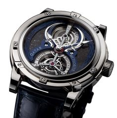 The LOUIS MOINET Qatar Tourbillon features a dial made of fragments from a meteorite found in Qatar after a 10-day hunt in the desert. The hand-engraved applique around the periphery of the dial depicts two bent swords and sand dunes, a tribute to the state of Qatar. With the Louis Moinet signature crown guard. | HauteTime