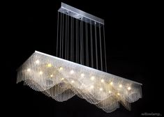 StreamWave is an exquisite dynamic pendant chandelier that plays with one's perception as it appears to transform from different viewpoints in subtle ways. The design is composed of staggered waves which evoke a subtle feeling of rhythmic movement. Illuminated by 20x G4 LEDs. #LinearChandeliers #DiningRoomChandeliers #DiningRoomCeilingLamps #LuxuryInteriorDesign #LightFixtures G4 Led, Suspended Lighting, Contemporary Chandelier, Higher Design, Pendant Chandelier, Luxury Interior Design, Light Fixtures, Ceiling Lights, Perception