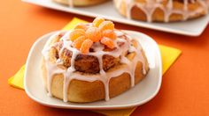 These playful cobweb cinnamon rolls are fun to serve for a Halloween-themed breakfast. The colorful spiders add to the fun!