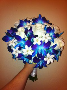 blue orchid and white rose wedding bouquet.