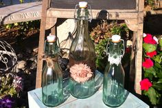 Rustic Chic Bottles/Jugs. Vintage Glass Jugs With Lace and Jute: Group of 3. Wedding Sand Ceremony, Shower Decor. Available via Etsy.