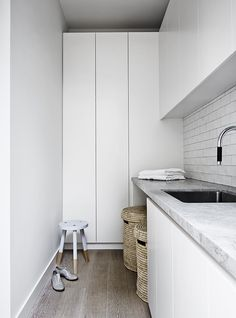 Laundry: white handleless cupboard/cabinet doors, grey marble-look stone benchtop with undermount laundry sink/basin, white handmade subway tile splash back Laundry Hamper, Laundry In Bathroom, Laundry Cupboard, Linen Cupboard, Laundry Area, Laundry Storage, Stone Benchtop, Mim Design, Small Laundry