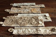 "-Rectangles of heavy linen, .75"" wider than your wrist. Pin on strips of lace, pieces of doilies, secure with tiny stitches. Sew button loops and buttons on..."