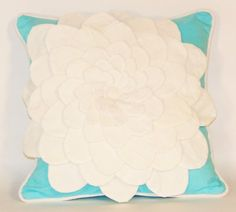 White Flower on Turquoise Background Pillow