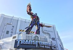 Guide to TRANSFORMERS: The Ride a fast-paced motion simulator ride in Universal Studios Florida in Orlando. Universal Studios Rides, Universal Studios Florida, Profile Pictures, Transformers, Statue Of Liberty, Orlando, Sci Fi, Fiction, 3d