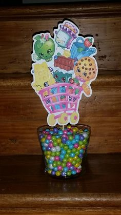 2 Shopkins Inspired Party Centerpiece's with 12 matching Cupcake Toppers by CarollsPartyWorld on Etsy https://www.etsy.com/listing/228713736/2-shopkins-inspired-party-centerpieces