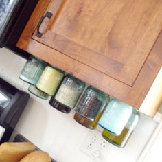 Mason Jar under the counter pantry. - interesting idea ... I would be scared of the jars falling and breaking.