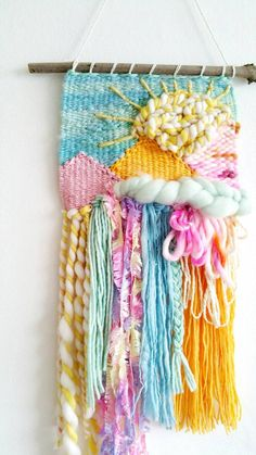 This piece is a mountain landscape in the bright of day, gleaming with bright pastel tones and the golden rays of the sun! Woven using an array of beautifully handspun yarns, vintage yarns and organic fibres. Some come from my own spinning wheel and some from the likes of Australia, America, Uruguay, or from home like the vintage fluffy pink goodness that Ive had since the age of 7 and vintage cotton from a quaint local market in my home county in England.  Snap it up now if your home needs…