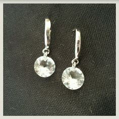 Beautifully simplistic Crystal drop earrings Very simple yet sparkly gorgeous diamond cut crystal earrings on silvertone hooks. Jewelry Earrings