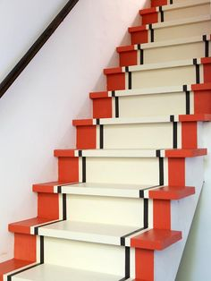 Painted steps for stairway down to restroom. Colors: Red and black are painted white, and the white is painted black.