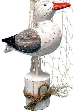 "Beachcombers International 12"" Wood Seagull On Piling With Rope by Beachcombers International. $13.19. Enhance your beach or nautical theme party decor with attractive and unique decorations like this exquisite painted wooden seagull. The inquisitive bird peers curiously from its perch atop a piling tied with rope, elegantly weathered and artfully designed. 12"" tall12.8 ozPainted wood/ropeSome minor assembly required. Perfect for a table centerpiece or table top..."
