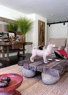 rock + reclaimed wood plank coffee table by  Antonio Martins Interior Design