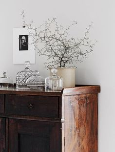 Wooden dresser with simple styling. From the home of interior stylist Pella Hedeby, photographed by Sara Medina for My Home magazine.