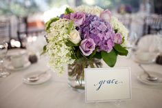 Lavender/lilac Wedding Flowers - We plan to do  centerpieces that will look a bit like this except the flowers will be right on the table in a dish that won't be seen. All the flowers will be in shades of  lilac and lavender. #lilaclavender #centerpieces #weddings
