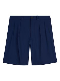 GQ Style Editor Luke Day shares his tips on how to master vacation dressing. Featured are these Christopher Kane Wool-Mix Shorts. Shop now on Style.com