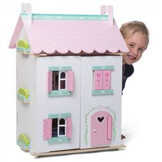The Le Toy Van Sweetheart Cottage Dolls House is a fully painted and decorated doll house with hearts and flowers motif and opening shutters, windows and door. Comes complete with a gorgeous 32 piece furniture and accessory set and is the perfect dolls ho Traditional Toys, Van Design, Mighty Ape, Wooden Dollhouse, Pretend Play, First Christmas, Wooden Toys, Toy Chest, Cleaning Wipes