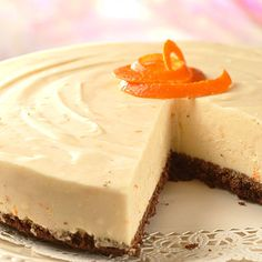 Orange White Chocolate Cheesecake is a velvety white chocolate cheesecake with a hint of orange. It is a sophisticated dessert that's rich and satisfying. From the kitchen of Rosilene McLean, Fremont, MI.