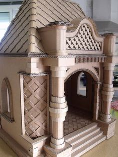 Is it a doll& house or a cat& castle or delightful dog den? Either way, it& made from cardboard. Cardboard Castle, Cardboard Playhouse, Cardboard Art, Cardboard Boxes, Cardboard Cat House, Cardboard Dollhouse, Cardboard Fireplace, Crafts With Cardboard, Cardboard Design