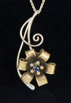 Bullet Flower Necklace. $145.00, via Etsy.  Bullet Art- Beautiful!