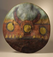 Native American:Weapons, Pueblo Buffalo Rawhide War Shield. Circa 1800. Diameter 23 in..This early, slightly convex war shield is composed o...