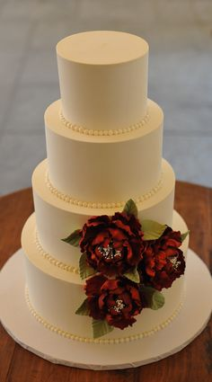 Classic flat iced buttercream with hot red peonies